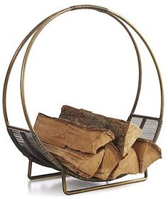 Need a place to house your excess logs? This brass holder has a unique shape and a lining on the bottom to catch twigs and other loose pieces of wood.