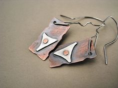 Handmade Riveted Copper and Silver Earrings -- i don't really like how these look but the idea with the rivet is gooood