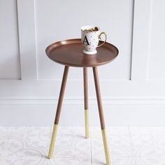 Copper Table With Brass Tipped Legs - metal is officially the material of the moment in homeware and jewellery.
