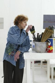 """""""Every so often every artist feels, 'I'll never paint again. The muse has gone out the window.' In 1985, I hardly painted at all for three months, and it was agonizing. I looked at reproductions. I stared at Matisse. I stared at the Old Masters. I stared at the Quattrocento. And I thought to myself - Don't push it! If you try too hard to get at something, you almost push it away.""""  Helen Frankenthaler (1928-2011) at her Connecticut studio in 2003. Photo by Suzanne DeChillo\ New York Times."""