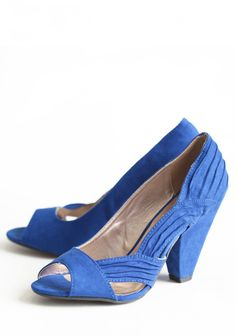 "Modern Elegance Peep Toe Pumps 42.99 at shopruche.com. These wonderfully soft faux suede pumps in vibrant cobalt blue are polished with a whimsical peep toe and unique textured accents.All man made materials, Slightly padded footbed, 4"" heel"