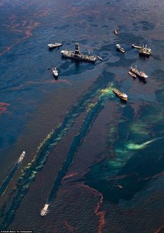 """Boats gather near remaining oil platforms near the site of the Deepwater Horizon wellhead, leaving oily wakes as they move through the polluted water. Nearly one third of all U.S. oil production comes from 3,500 such platforms in the Gulf of Mexico."""
