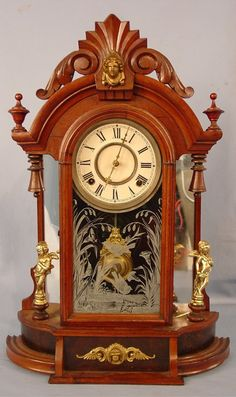Gilbert Walnut Victorian Figural Mantle Clock