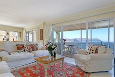 This Stunning Simonstown Self Catering Accommodation 3 Bedroom holiday home with beautiful views and holiday feel.  It is less than 10 minutes walk to Seaforth beach and the world famous Boulders beach where you can swim with the Penguins.  The rooms are very light and bright even on dull days and every room has access to a balconies with wonderful views. Wet Room Bathroom, Ensuite Bathrooms, Holiday Accommodation, Luxury Accommodation, Cape Town Holidays, Boulder Beach, Pull Out Bed, Bedroom Doors, Wet Rooms