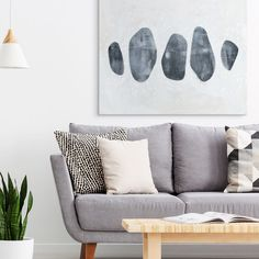 A modern design of a row of gray stones against a light gray backdrop with small white spots. Stone Collection I Scandinavian Art by Emma Scarvey from Great BIG Canvas. Cozy Living Rooms, Living Room Art, Interior Design Living Room, Living Room Designs, Scandinavian Interior, Hygge, Wall Art Decor, Grey Art, Gray