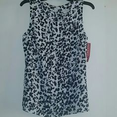 **NWT** Very cute Merona top **NWT** Very cute Merona top, size Medium. The color is black and a creamy white.. Can dress up or down ! Merona Tops