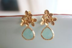 Beautiful cherry blossom studs in 16K gold plated with a tiffany blue stone wrapped in 16K gold around the edge