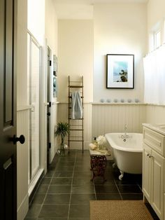bathroom - beadboard - tub - slate floor like the dark floor with light walls and furniture