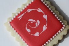 red cookie with pink marbled hearts swirl