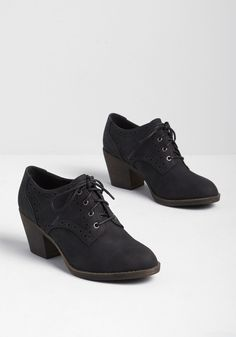 Channel a sweet and sophisticated look this season in these black booties from Rocket Dog. What sets this stacked heel boot apart from the rest? Its faux-leather upper with perforated details and lace closures. Brown Booties, Lace Up Booties, Women's Booties, New Balance, Heeled Boots, Shoe Boots, Ankle Boots, Stiletto Boots, Shoes 2018