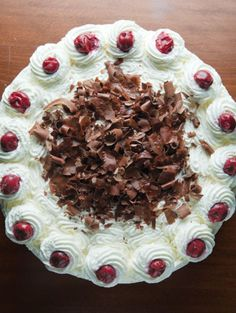 This classic, German, cherry-filled chocolate cake, a masterpiece of cherry brandy-soaked pastry engineering, improves the longer it sits.