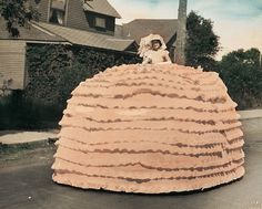 """My grandmother, Mary Svetich Rozman, was 16 years old when she was Queen of the May at the May Day parade in Calumet, Michigan in 1917,"" writes Cathy Rozman from Plymouth. ""The trick to this float is that she's standing on a car underneath the giant skirt!"
