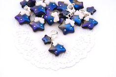 Your planner will be out of this world with this galaxy themed star planner charm! Expertly handcrafted from high quality polymer clay this kawaii charm is carefully hand painted with artist grade pigments, and glazed for the highest shine to encompass the colour shifts of the universe in one tiny charm.  The purchase of this listing is for one kawaii star charm measuring approximately 1,5 centimeters (0.6 inches) in width. This kawaii charm comes attached to a silver plated lobster clasp…