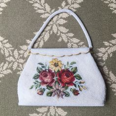 Vintage bead and needlepoint handbag Beaded with needlepoint flowers. Hardware/bag exterior in perfect condition. Underside of beaded strap has 3 small spots. Satin lining (see pic). Vintage Bags Clutches & Wristlets