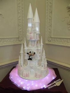 Deborah's amazing wedding cake complete with their own MIckey and Minnie figurines from Euro Disney! Baby Blue Wedding Theme, Baby Blue Weddings, Mickey Mouse Wedding, Minnie Mouse Cake, Castle Wedding Cake, Wedding Cakes, Beautiful Cakes, Amazing Cakes, Wedding Ideas