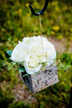 Green and white centerpiece in a birch container. #rustic #elegant #wedding
