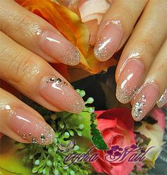 Super shiny nude gel nails with glitter gradient tips and crystals by Japanese nailblog Ageha Nails