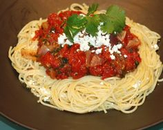 Rustic Pasta Sauce with deep tomato flavor rich with garlic and hints of cilantro. Freezes well to bring the taste of summer to cold winter evenings!