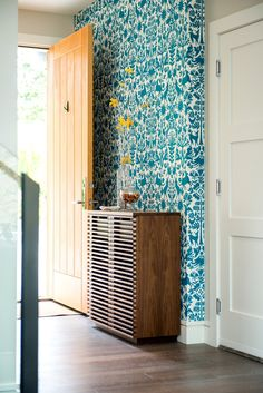 The bold wall graphic in the entry sets the stage, welcoming you into the home of some fun loving people. The custom walnut shoe cabinet was designed to perfectly fit the narrow entry, built by the ridiculously talented Ian Erdmann of Woodshop 506.