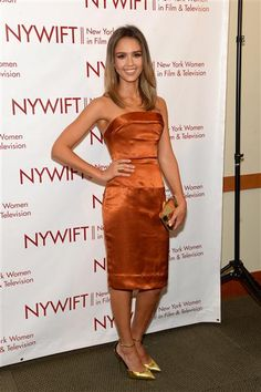 "Jessica Alba looked super chic in a rust-orange strapless Vivienne Westwood dress at the 2014 New York Women In Film And Television ""Designing Women"" Awards Gala in New York on June 18, 2014."