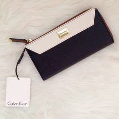 ✨LOWEST✨ NWT Calvin Klein wallet New with tags. Calvin Klein wallet. Black, tan, and white with gold accents and interior. Accepting offers! Calvin Klein Bags Wallets