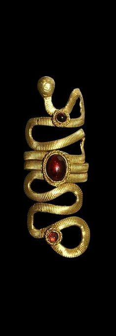 Egyptian Gold Serpent Ring Roman Period, 30 BC-323 AD. A flat-section finger ring.                                                                                                                                                                                 More