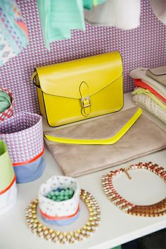 Satchel with buckle, envelope bag with neon accent, necklace with chain and ribbon, fabrics.  By Veritas.