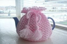 A girly teacosy--nice I-cord tie..