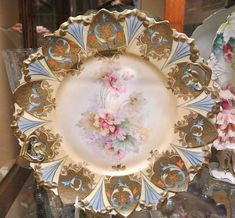 This is a very pretty, rare and hard to find, RS Prussia 10 cake plate RS Prussia mold 98, pink floral decor and heavy gold buff edges. You
