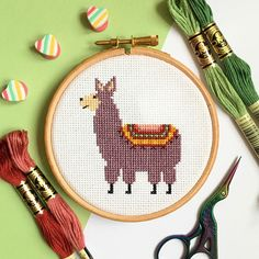 A little llama modern, fun and easy cross stitch kit that is great for beginners and more experienced stitchers alike. The antique violet colour with splashes of green and pink gives this kits an extra piece of uniqueness and the sprinkling of metallic thread makes your llama subtly