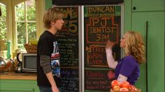 Disney's Good Luck Charlie - the fabulous Double Door Chalkboard Refridgerator and the gorgeous light green Craftsman style wood cabinets. family scheduling on the chalkboard doors. bright white Craftsman windows. great TV kitchen sets