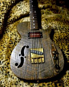 "Postal Guitars: "" This is made from Barn-wood found near the highway 61 cross-roads in the Mississippi delta. It sounds incredible. It has a Fatboy P90 at the neck and a fender American Tele bridge pickup. The body is chambered and light."""