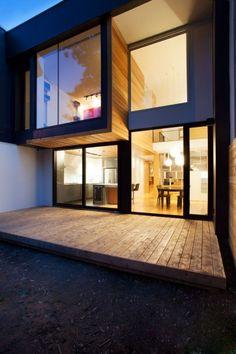 blonde cedar and dark windows/exterior