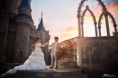 A Cinderella-worthy Disney bride and her prince pose for some stunning bridal portraits in front of the castle at Magic Kingdom #Disney #wedding