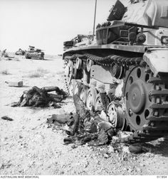 Grim reality of war...two crewman of this Pzkw III tried to escape by the side hatch...but to no avail... 6th Company , 15th Pz. Division