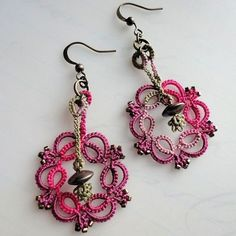 Kinetic tatted earrings by yarnplayer, via Flickr