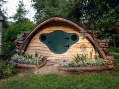 Hobbit Hole Playhouse.  I think my parents need to build one of these in their backyard.