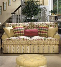 cottage floral sofa. I'm getting so I just adore sofas comprised of different fabrics--it makes the monotoned ones boring by comparison