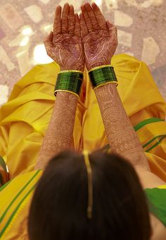 Yellow saree with gold border, green chuda (bangles), and mehendi (heena) design on hands. This is a very typical rather traditional look for a Maharshtrian bride from India's West coastal state of Maharashtra. Usually, during pre-wedding haldi (tumeric) ceremony, and wedding rituals. ~Sayali