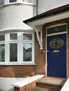 Eye-catching front door and frame in cobalt blue and white, with polished chrome door furniture. This blue door is a great example of the bespoke designed front door with a smart stained glass. Garage Door Styles, Garage Door Design, Front Door Design, House Front Door, Glass Front Door, Fromt Doors, 1930s Doors, Faux Wood Garage Door, Victorian Front Doors