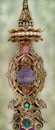 Kwan Yin is the Goddess of infinite compassion and love is seated on a  twelve peddled lotus adorned with pearls.  Shown here with Lemurian Seed crystal, amethyst pyramid and labradorite.