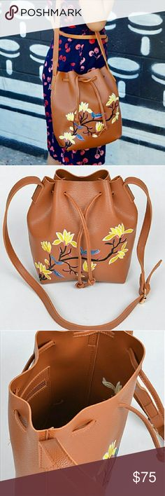 SOON! Faux Leather Floral Embroidery Bucket Bag Camel colored, faux leather bucket cross-body bucket bag with lovely floral embroidery. More info soon! Pink Haley Bags Crossbody Bags