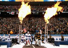 Canadiens goaltender Mike Condon and Bruins goaltender Tuukka Rask lead their respective teams out onto the ice for the 2016 Winter Classic. (Dave Sandford/NHLI via Getty Images)