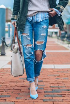 distressed denim, mixed prints, blue and white striped button up, knit, and olive jacket