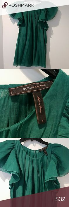 BCBG MaxAzria Emerald Green Blouse This beautiful blouse has flutter sleeves and a button closure on the back. So soft and fairy... in prefect condition.  *Pet and smoke-free home! I often adjust my price during Posh parties and promos, keep an eye out!! Offers welcomed!  BUNDLE AND SAVE!! BCBGMaxAzria Tops Blouses
