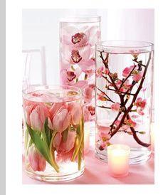 Dollar store vases+ silk flowers glued to bottom of vases+distilled water=wedding center pieces!!