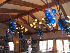 Ceiling Balloons: Give Balloon Classics a call Keep your decorations on the ceiling to give more room for guests. Balloon Ceiling, Ceiling Decor, Balloon Arch, Balloons, Ceiling Lights, Balloon Clusters, Balloon Decorations, Arch Decoration, Balloon Bouquet
