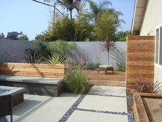 Modern poured in place pavers. I love the large scale of the pavers and added wood details in the yard!