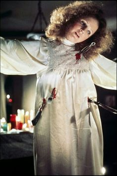 • Carrie • (1976) - Margaret White play by Piper Laurie - ending with an orgasm as she's being crucified - I mean come on - GENIUS! Played to perfection.