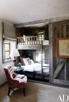 The bunk room is partially sheathed in reclaimed corral boards | archdigest.com
